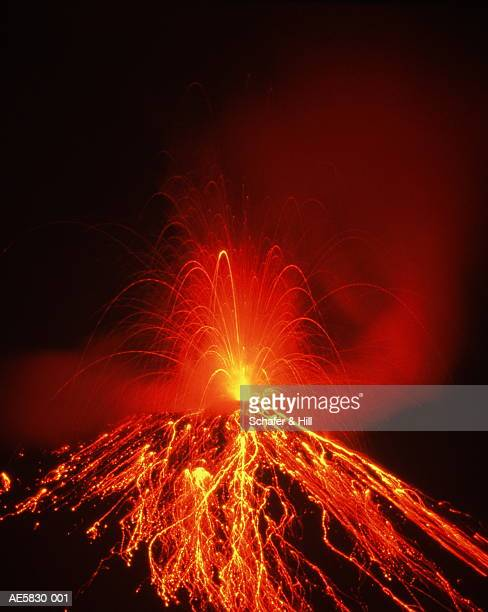 Costa Rica, Arenal Volcano erupting at night