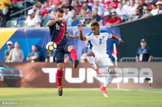 Costa Rica Defender Francisco Calvo and Panama Midfielder Edgar Barcenas both go for the ball in the first half during the CONCACAF Gold Cup...