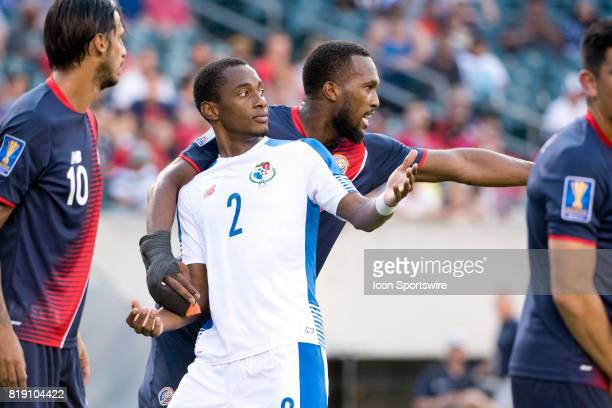 Costa Rica Defender Kendall Waston hangs on to Panama Defender Michael Murillo on a free kick in the second half during the CONCACAF Gold Cup...