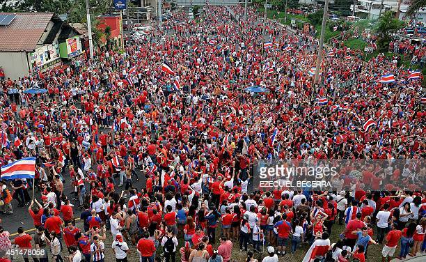 Costa Rica fans celebrate in San Jose on June 29 2014 after their team defeated Greece in the Brazil 2014 FIFA World Cup Round of 16 football match...