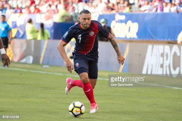 Costa Rica Forward David Ramírez pushes the ball forward in the first half during the CONCACAF Gold Cup Quarterfinal game between Costa Rica and...