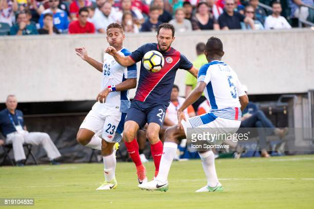 Costa Rica Forward Marco Ureña gains control between Panama Defender Roberto Chen and Panama Defender Fidel Escobar in the first half during the...