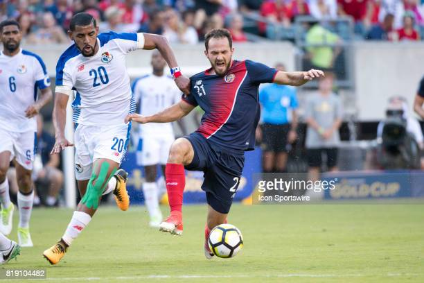 Costa Rica Forward Marco Ureña is brought down near the net by Panama Midfielder Aníbal Godoy in the first half during the CONCACAF Gold Cup...