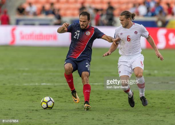 Costa Rica forward Marco Ureña tries to keep the ball away from Canada midfielder Samuel Piette during the CONCACAF Gold Cup Group A match between...