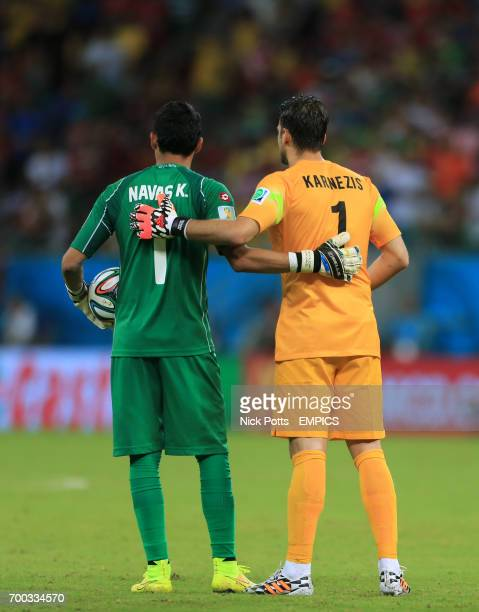 Costa Rica goalkeeper Keylor Navas and Greece goalkeeper Orestis Karnezis arm in arm before the penalty shootout