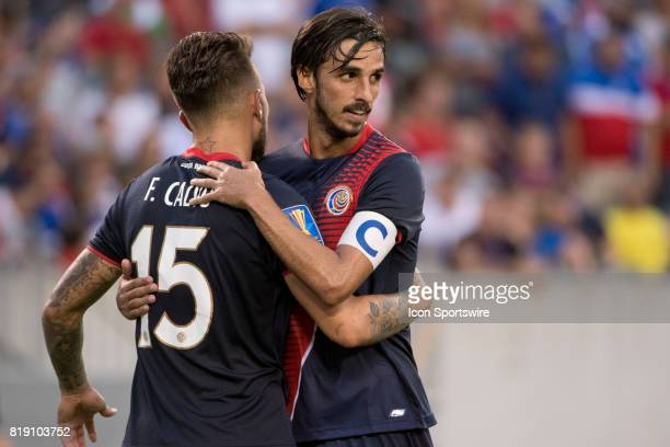 Costa Rica Midfielder Bryan Ruiz celebrates with Costa Rica Defender Francisco Calvo after winning the CONCACAF Gold Cup Quarterfinal game between...