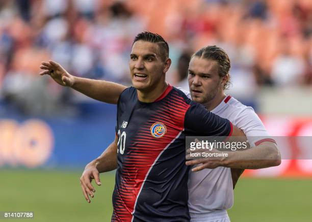 Costa Rica midfielder David Guzman and Canada midfielder Samuel Piette jockey for position during a corner kick during the CONCACAF Gold Cup Group A...