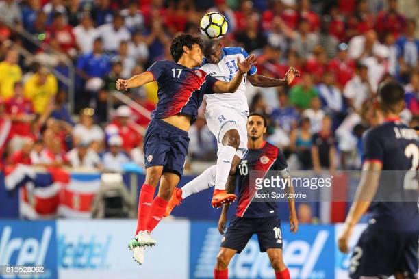 Costa Rica midfielder Yeltsin Tejeda goes up for a headball against Honduras midfielder Oscar Boniek Garcia during the second half of the CONCACAF...