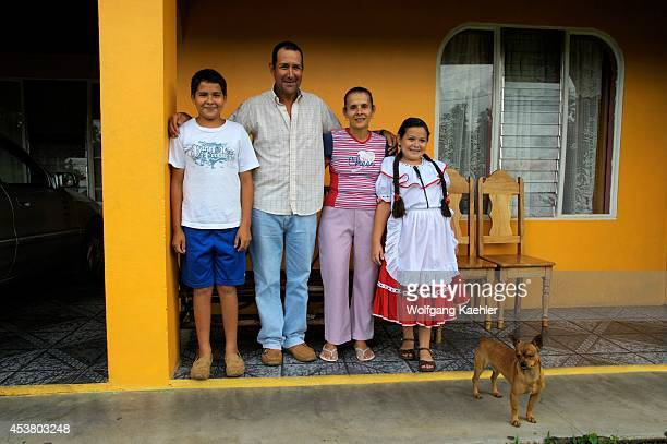 Costa Rica Near Arenal Small Village Family In Front Of Home