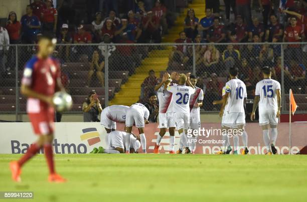 Costa Rica players celebrate at halftime after scoring against Panama during their 2018 World Cup qualifier football match in Panama City on October...