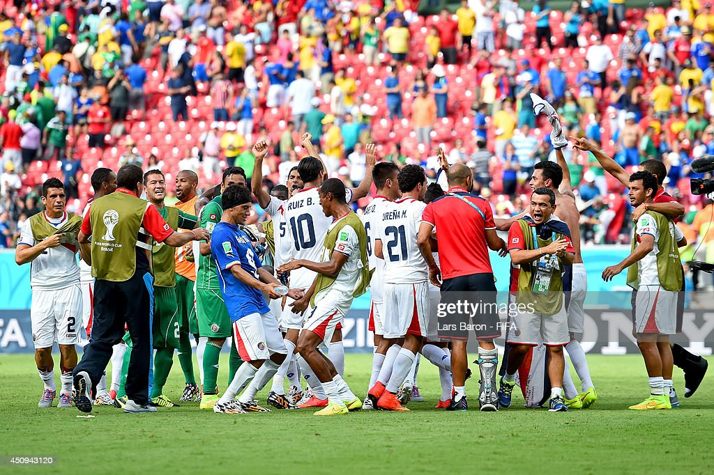 Costa Rica players celebrate the 1-0 win after the 2014 FIFA World Cup Brazil Group D match between Italy and Costa Rica at Arena Pernambuco on June 20, 2014 in Recife, Brazil.