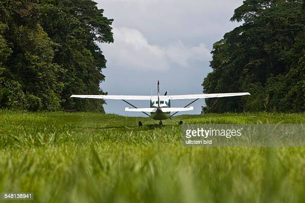 Costa Rica Puerto Jimenez Cessna 206 on the runway of the ranger station in Corcovado National Park Osa peninsula