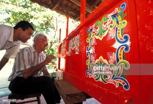 Costa Rica Sarchi Visitor Watching Artist Painting Oxcart By Hand