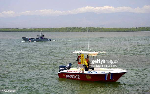 A Costa Rican coast guard boat and a firefighters rescue boat monitor the beach in Puntarenas 95 km north of San Jose Costa Rica on May 3 after...