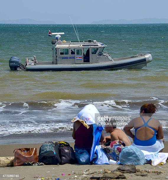 A Costa Rican coast guard boat monitors the beach in Puntarenas 95 km north of San Jose Costa Rica on May 3 after authorities declared an emergency...