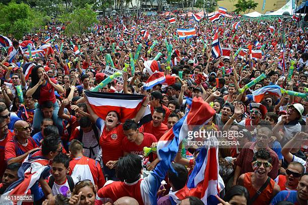 Costa Rican fans watch the Brazil 2014 FIFA World Cup football match against England in a giant screen at Democracy Square in San Jose on June 24...