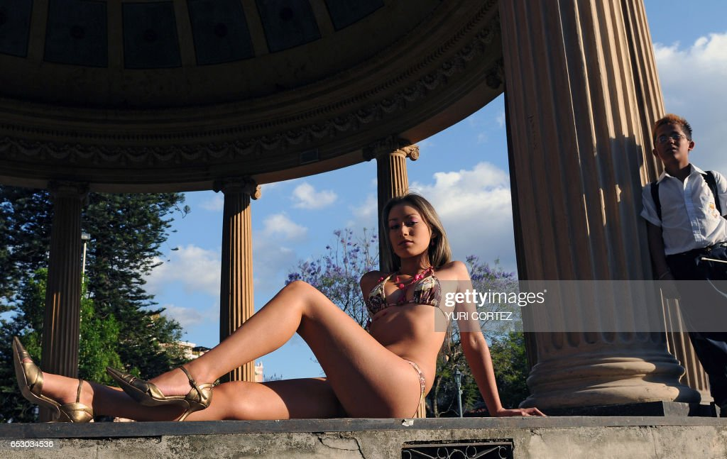 Costa Rican model Priscilla Montoya poses during a photo session at Morazan Park, in San Jose, on February 28, 2008. Montoya is one of the nine Venezuelan and Costa Rican girls selected from a group of around eighty, who is seeking to be chosen winner of the 'Summer Girl' contest. AFP PHOTO/ Yuri CORTEZ /