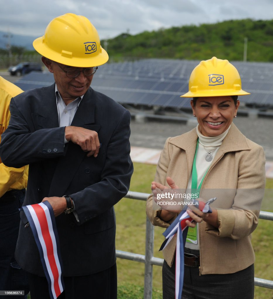 Costa Rican President Laura Chinchilla (R) and Japanese ambassador Yoshiharu Namiki smile during the inauguration of the Miravalles Solar Power Plant in Miravalles, 220 km north of San Jose, on November 22, 2012. Costa Rica inaugurated the largest plant of electricity from solar energy in Central America, which may generate 1.2 gigawats a year and was built with funds from the Japanese government. AFP PHOTO/Rodrigo ARANGUA