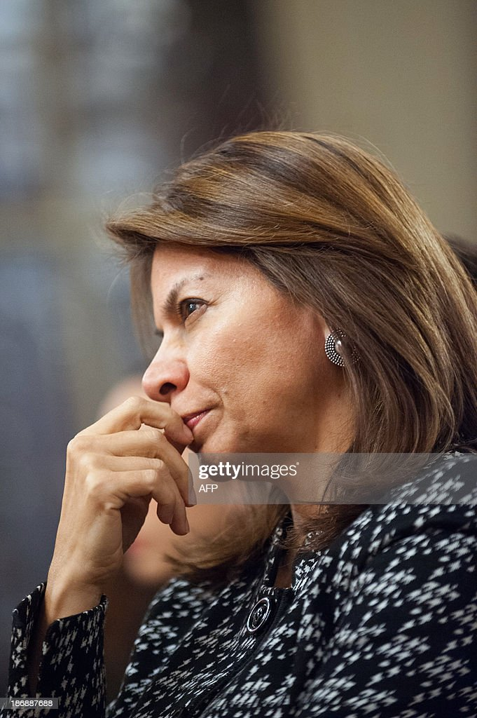 Costa Rican President Laura Chinchilla listens to a speech during a meeting with students, on November 4, 2013 at the Euro-Latino American political science university campus in the central French town of Poitiers, as part of her official visit to France.