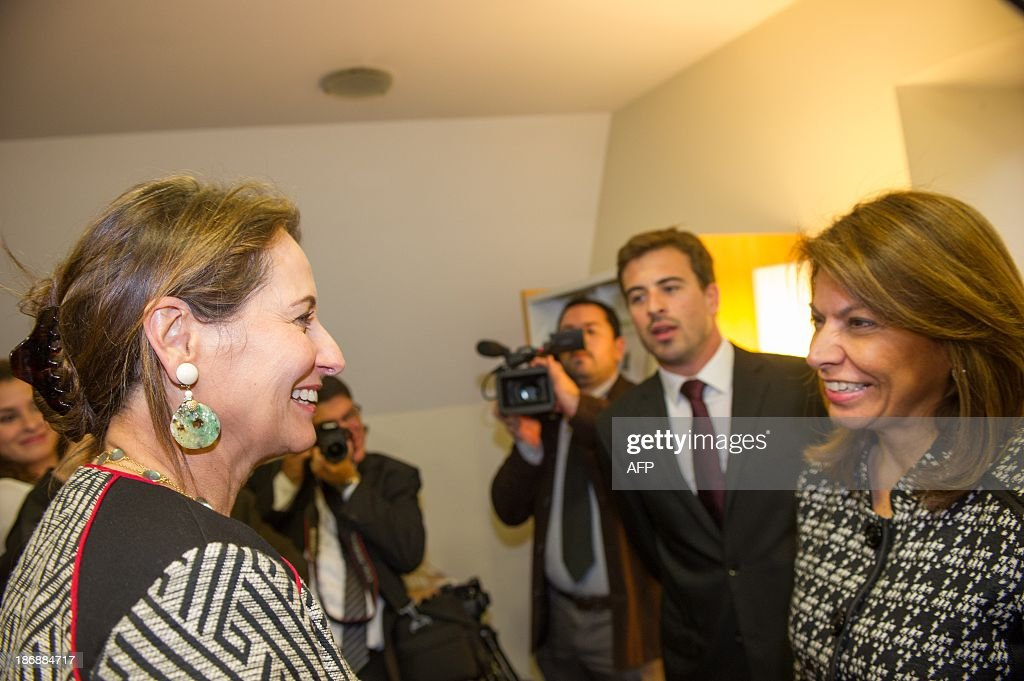 Costa Rican President Laura Chinchilla (R) meets on November 4, 2013 the president of the Poitou-Charente region, Segolene Royal, at the Euro-Latino American political science university campus in the central French town of Poitiers.