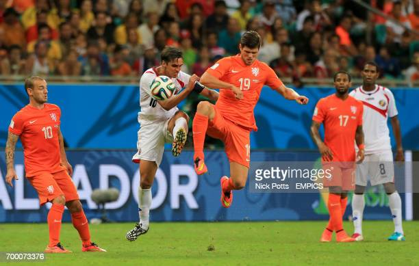 Costa Rica's Bryan Ruiz and Netherland's KlaasJan Huntelaar battle for the ball
