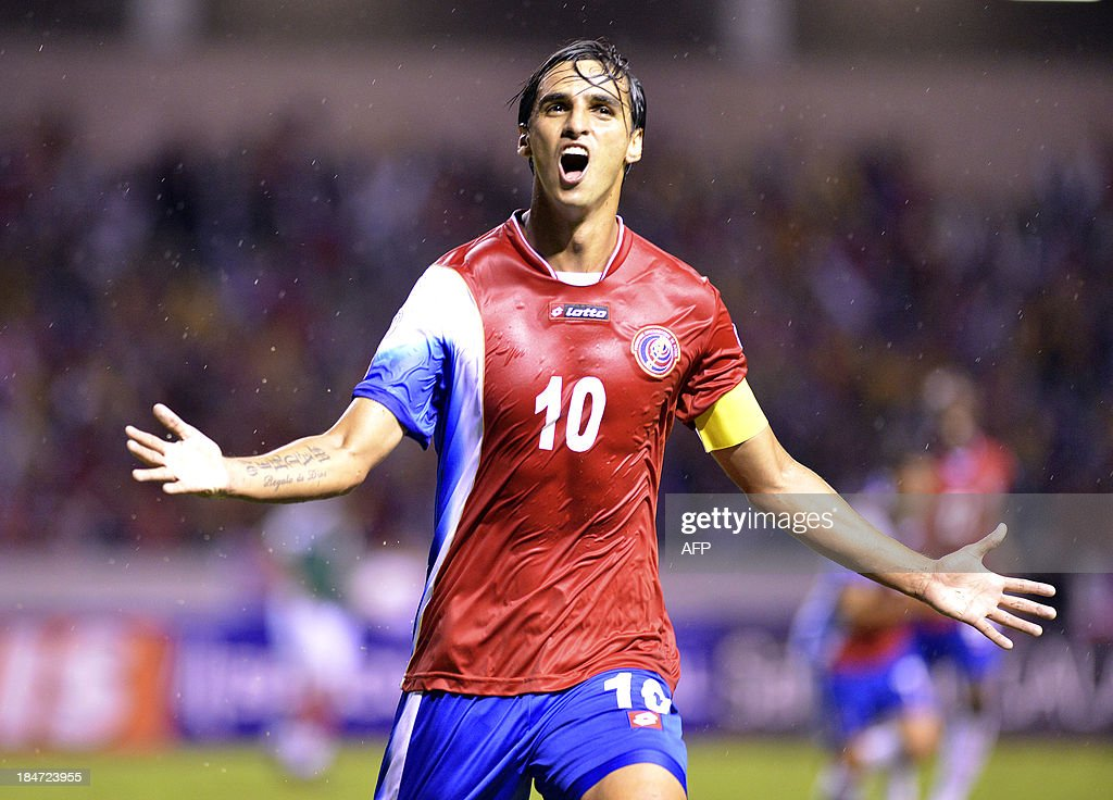 Costa Rica's <a gi-track='captionPersonalityLinkClicked' href=/galleries/search?phrase=Bryan+Ruiz&family=editorial&specificpeople=714489 ng-click='$event.stopPropagation()'>Bryan Ruiz</a> celebrates after scoring against Mexico during their Brazil 2014 FIFA World Cup Concacaf qualifier match at the Nacional stadium in San Jose, on October 15, 2013. AFP PHOTO / EZEQUIEL BECERRA