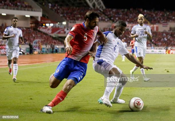 Costa Ricas Celso Borges fights for control of the ball with Panamas Fidel Escobar during their World Cup 2018 CONCACAF qualifiers football match in...