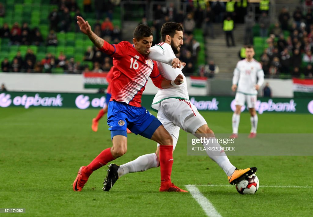 Costa Rica's Cristian Gamboa (L) vies with Hungary's Daniel Nagy vie for the ball during the international friendly football match Hungary v Costa Rica in Budapest, on November 14, 2017. /