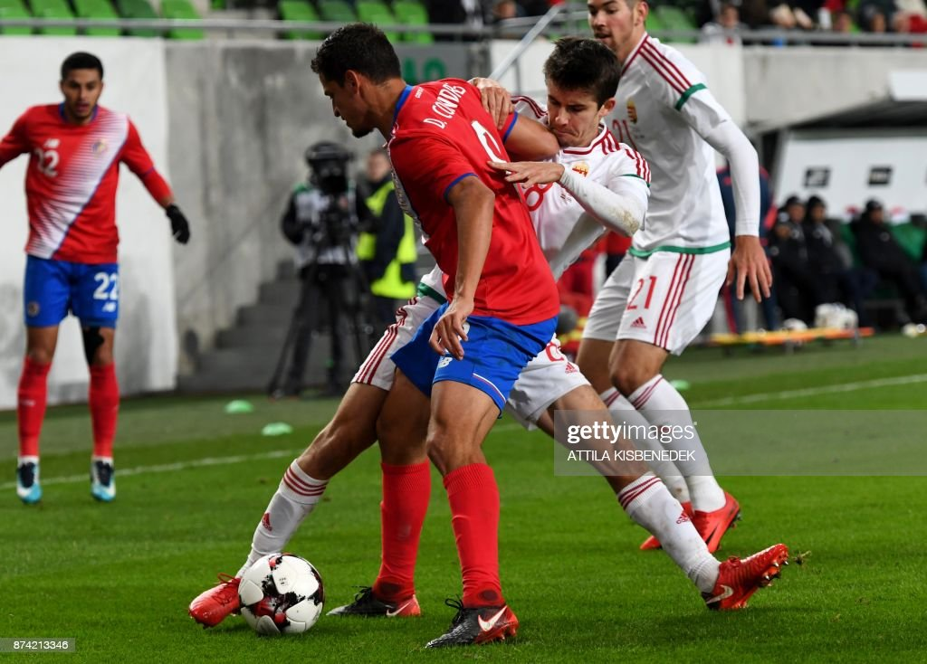 Costa Rica's Daniel Colindres (C) vies with Hungary's Adam Nagy vie for the ball during the international friendly football match Hungary v Costa Rica in Budapest, on November 14, 2017. /