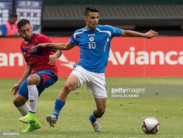 Costa Rica's David Ramirez vies with Nicaragua's Juan Barrera during a Central American Cup Tigo 2014 USA group match at RFK stadium in Washington on...
