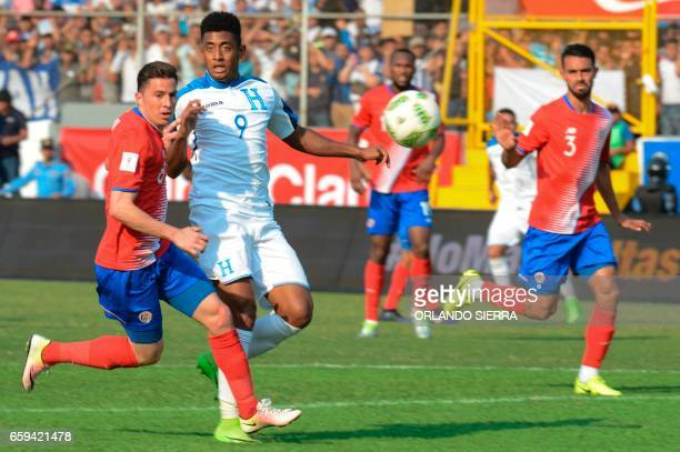 Costa Rica's defender Bryan Oviedo vies for the ball with Honduras' forward Anthony Lozano during their 2018 FIFA World Cup qualifier football match...