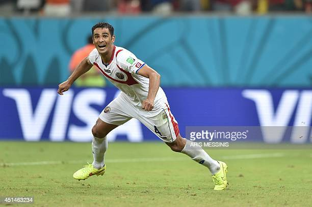 Costa Rica's defender Michael Umana celebrates after wining a Round of 16 football match between Costa Rica and Greece at Pernambuco Arena in Recife...