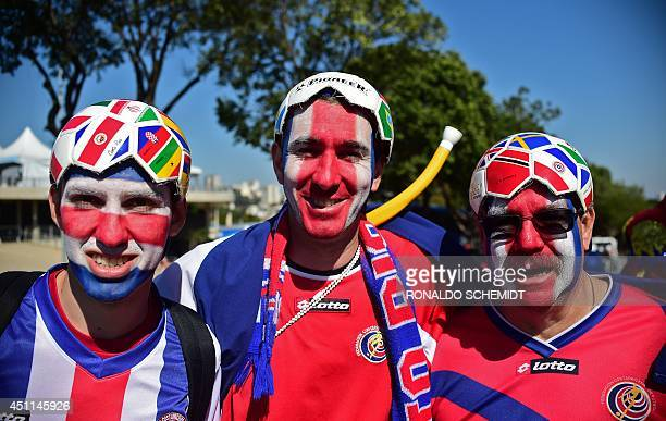 Costa Rica's fans pose upon their arrival at the Mineirao Stadium in Belo Horizonte on June 24 2014 before the Group D football match between Costa...