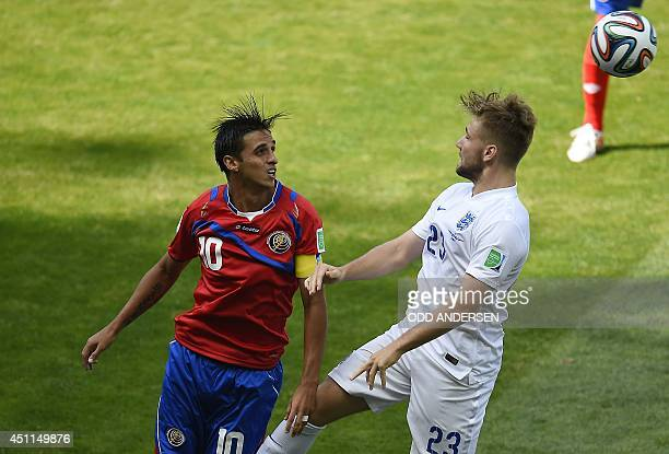 Costa Rica's forward and captain Bryan Ruiz tackles England's defender Luke Shaw during the Group D football match between Costa Rica and England at...