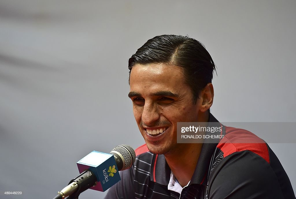 Costa Rica's forward <a gi-track='captionPersonalityLinkClicked' href=/galleries/search?phrase=Bryan+Ruiz&family=editorial&specificpeople=714489 ng-click='$event.stopPropagation()'>Bryan Ruiz</a> smiles during a press conference after a training session at the Vila Belmiro Stadium FC in Santos on June 11, 2014, on the eve of the opening game of the FIFA 2014 World Cup in Brazil. AFP PHOTO/ RONALDO SCHEMIDT
