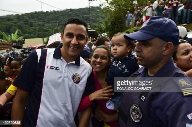 Costa Rica's goalkeeper Keylor Navas poses with Brazilian fans during the visit of the Costa Rica's national team to the 'Padre Lucio Floro' school...