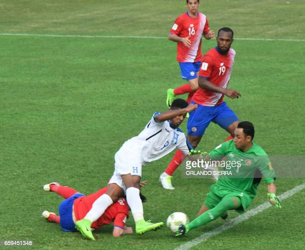 Costa Rica's goalkeeper Keylor Navas vies for the ball with Honduras' forward Anthony Lozano during their 2018 FIFA World Cup qualifier football...