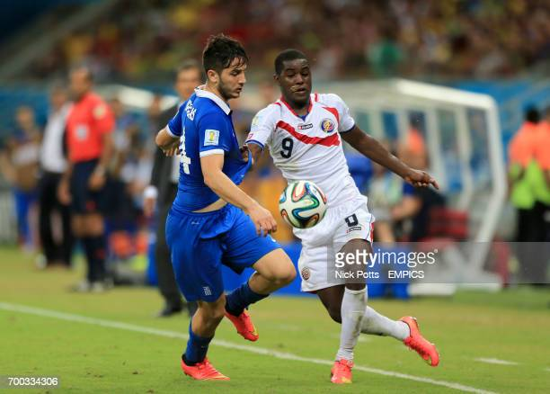 Costa Rica's Joel Campbell and Greece's Kostas Manolas battle for the ball