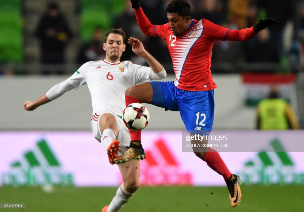 Costa Rica's Jose Guillermo Ortiz (R) vies with Hungary's Zsolt Korcsmar during the international friendly football match Hungary v Costa Rica in Budapest, on November 14, 2017. /