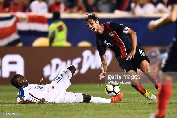 Costa Rica's midfielder Bryan Ruiz is challenged by Honduras' midfielder Oscar Boniek during their 2017 Concacaf Gold Cup Group A match at the Red...