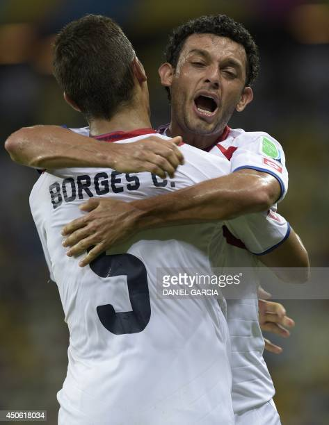 Costa Rica's midfielder Celso Borges and Costa Rica's midfielder Michael Barrantes celebrate after a Group D football match between Uruguay and Costa...