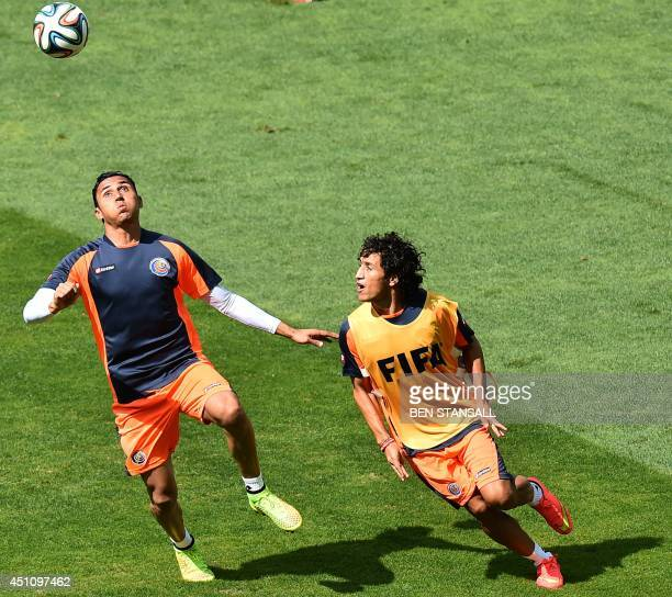 Costa Rica's midfielder Cristian Bolanos and goalkeeper Keylor Navas watch the ball as they attend a training session at The Mineirao Stadium in Belo...