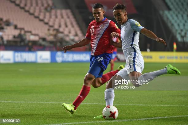 Costa Rica's midfielder Eduardo Juarez fights for the ball with England's forward Dominic CalvertLewin during their U20 World Cup round of 16...