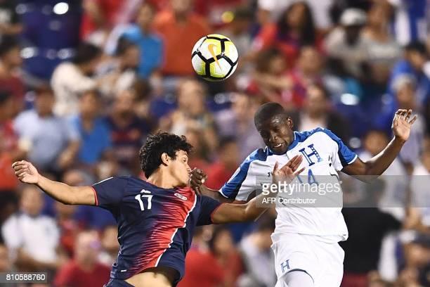 Costa Rica's midfielder Yeltsin Tejeda and Honduras' midfielder Oscar Boniek Garcia vie for the ball during their 2017 Concacaf Gold Cup Group A...