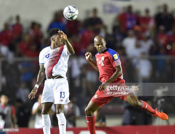 Costa Rica's Rodney Wallace and Panama's Adolfo Machado vie for the ball during their 2018 World Cup qualifier football match in Panama City on...