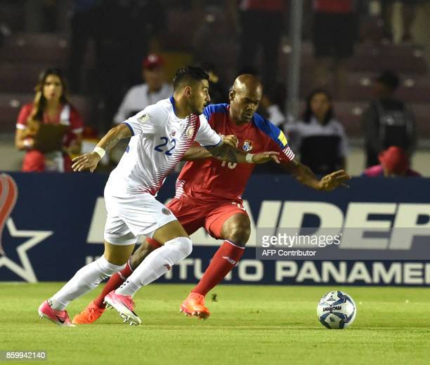 Costa Rica's Ronald Matarrita vies for the ball with Panama's Armando Cooper during their 2018 World Cup qualifier football match in Panama City on...
