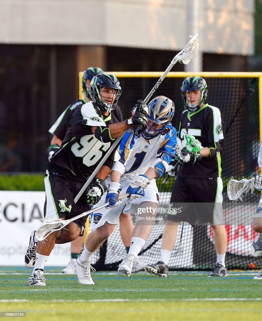CJ Costabile #96 of the New York Lizards in action against Matt White #1 of the Charlotte Hounds during their Major League Lacrosse game at Shuart Stadium on May 31, 2013 in Uniondale, New York. The Hounds defeated the Lizards 14-12.