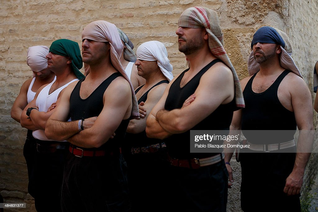 'Costaleros' from 'Vera-Cruz' brotherhood wait for the start of a procession on April 14, 2014 in Seville, Spain. Easter week is traditionally celebrated with processions in most Spanish towns.