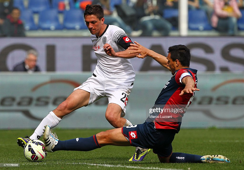 Costantin Nica of AC Cesena cis challenged by Nicolas Andres Burdisso of Genoa CFC during the Serie A match between Genoa CFC and AC Cesena at Stadio Luigi Ferraris on April 26, 2015 in Genoa, Italy.