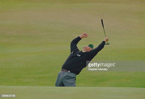 Costantino Rocca of Italy celebrates his birdie putt on the 18th green to force a playoff with John Daly on 23 July 1995 during the Open Championship...